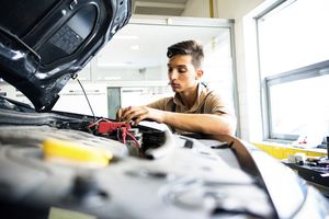 Man working on car battery