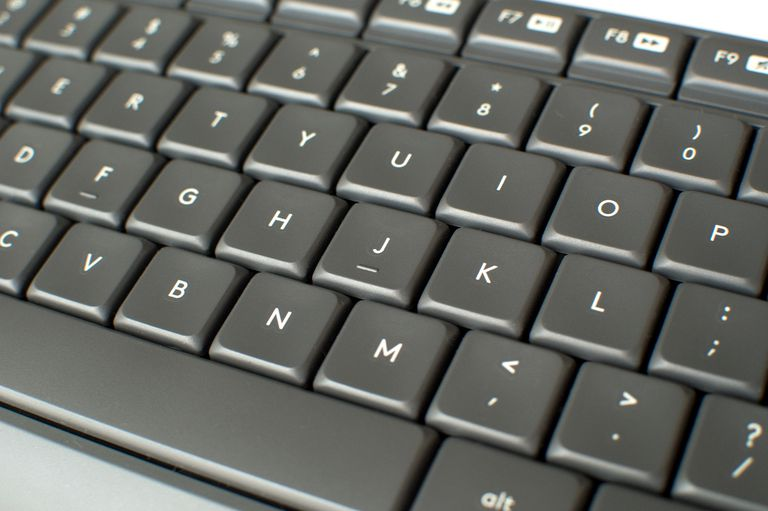 Close up picture of a gray keyboard
