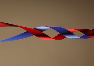 Red and blue colored bands intertwining