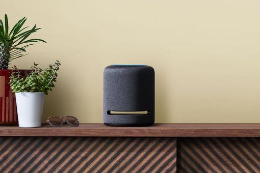 Amazon Echo Studio sitting on bookcase
