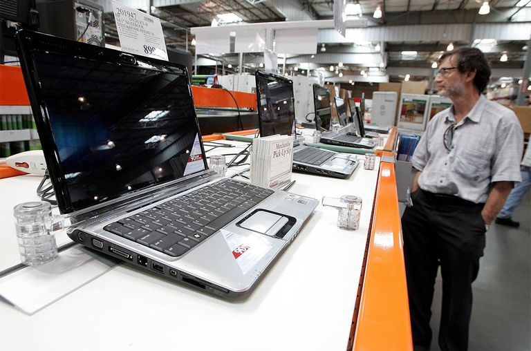 A customer looks at a display of laptop computers at a Costco warehouse store July 13, 2007 in Richmond, California.