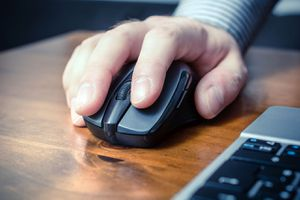 Image of someone using a wireless mouse