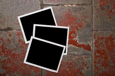 Blank photo frames lying on a brick floor