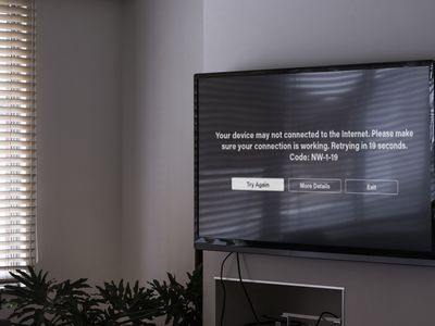 A TV mounted on the wall displaying the Netflix error NW-1-19.