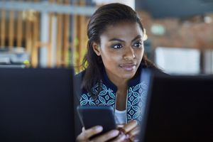 Businesswoman sending message at computer in office