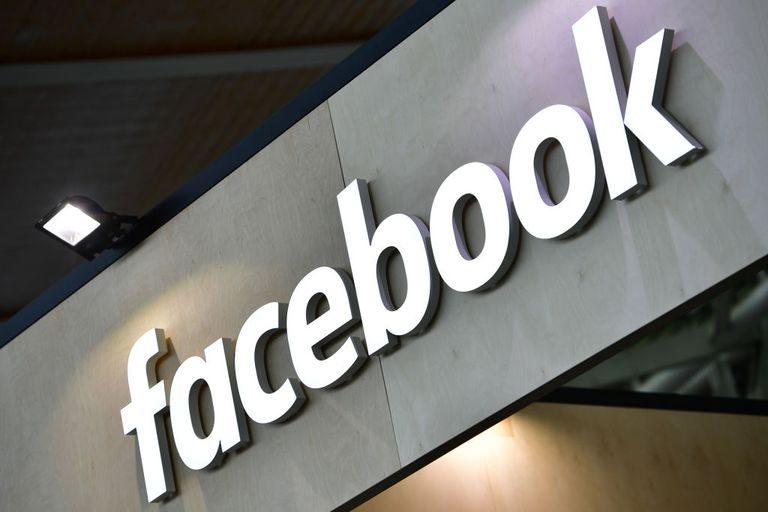 The Facebook logo is displayed at the 2018 CeBIT technology trade fair on June 12, 2018