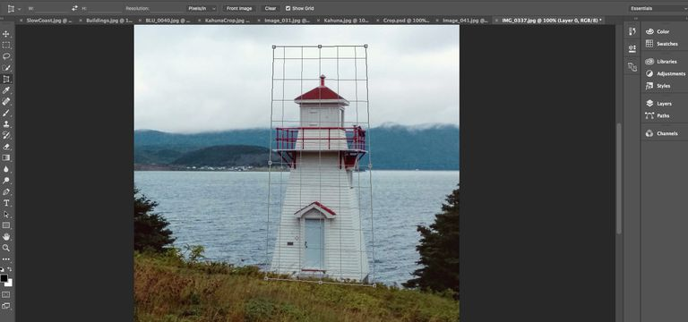 The Perspective Crop Tool is selected and the Mesh for the crop area is shown over a lighthouse.