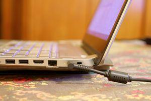 Charging a laptop via its charging port