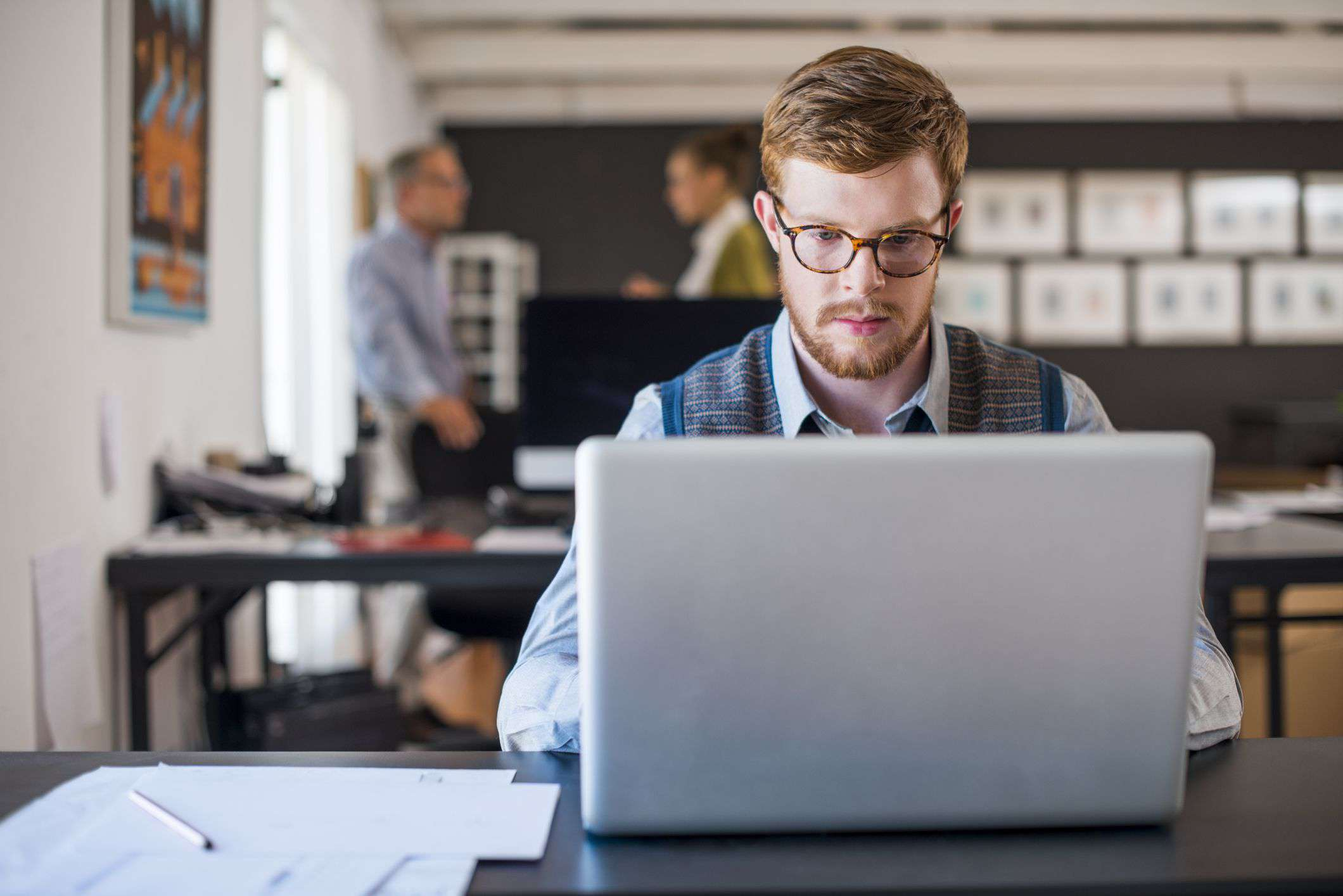 man on laptop in office