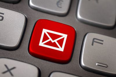 Red email button on computer keyboard
