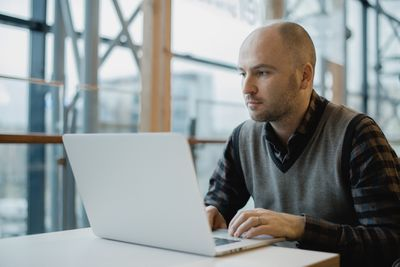 Software developer using laptop