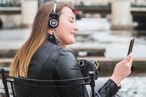 Someone wearing wireless Koss Porta Pro headphones outdoors.