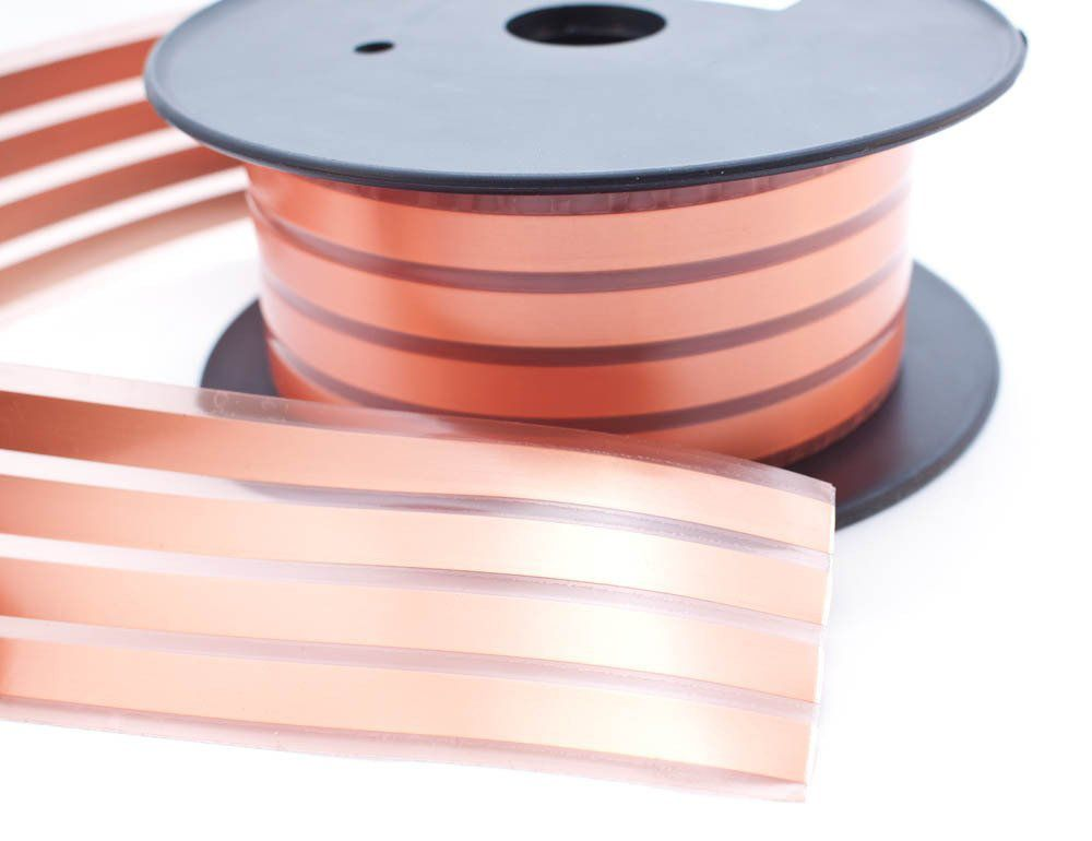 Close up of a spool of flat adhesive speaker wire