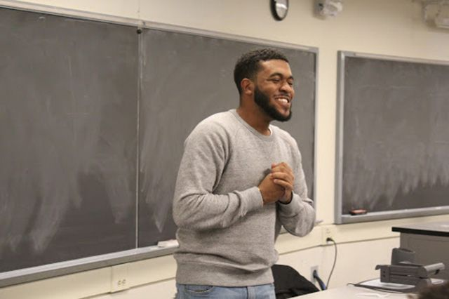 Jehron Petty speaking in a classroom.