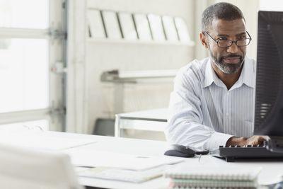Businessperson at desktop computer