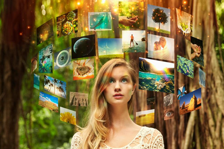 Screens floating around woman in forest