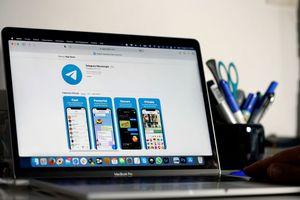 Apple MacBook Pro showing Telegram social media application.