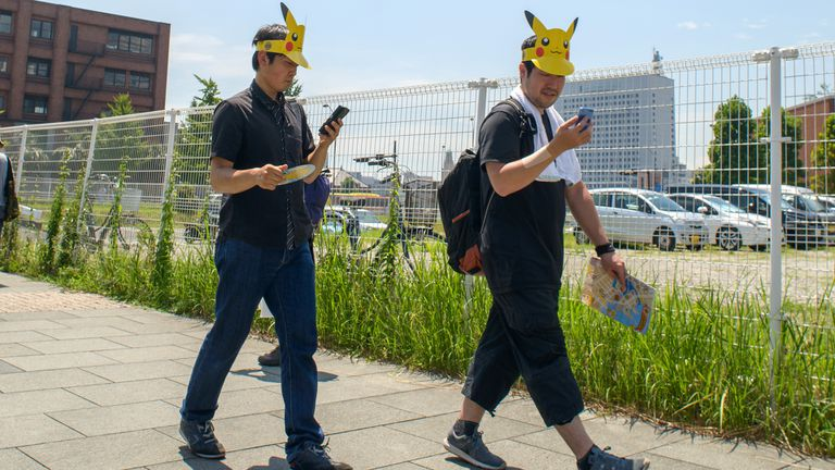 Two Pokemon Go players walking in Japan.