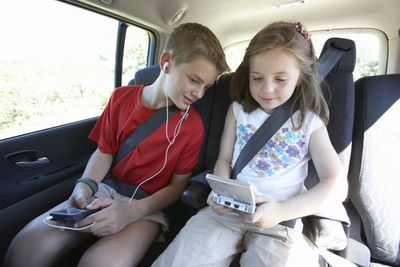 Nintendo DS kids in back of vehicle