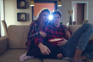 Two people watching a movie in a home theater