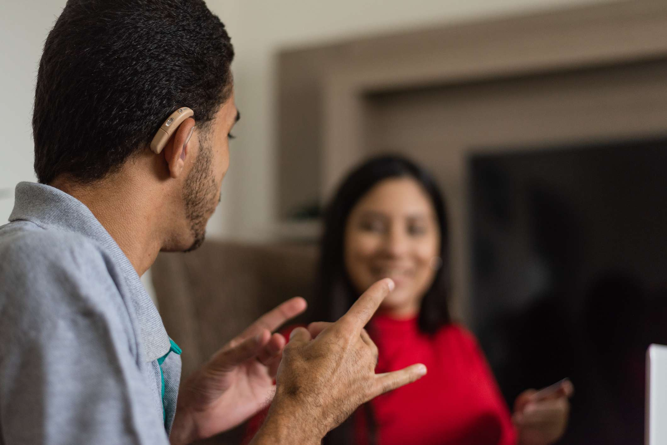 Two people having a conversation using ASL.