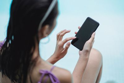 A woman looking at a smartphone.