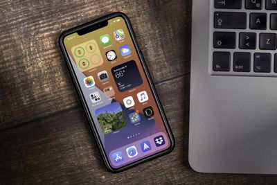 iPhone showing iOS 14 home screen and layout