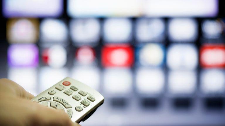 A man using a smart TV
