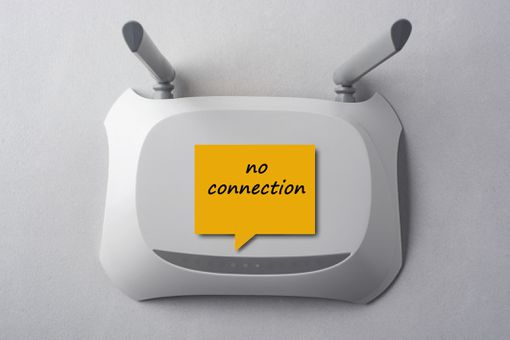 """Wi-Fi router with a sticker with the words """"no connection"""" written on it"""
