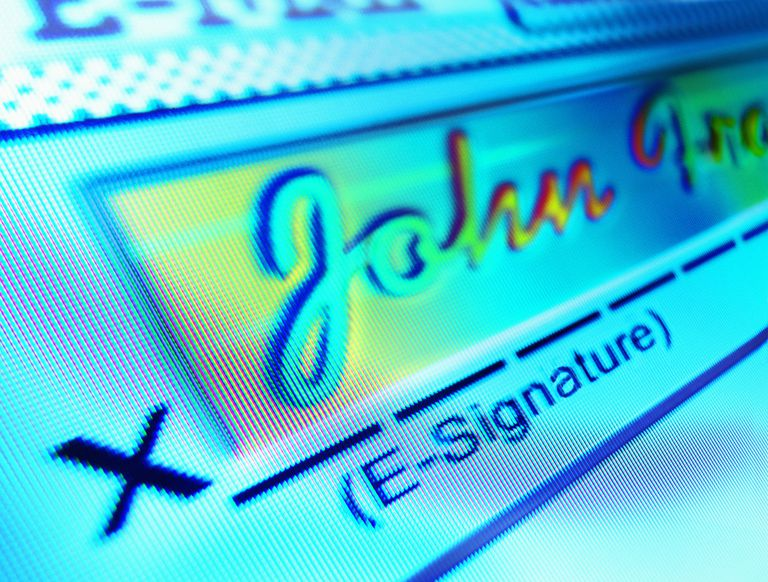 E-signature on computer screen, close-up (Enhancement)
