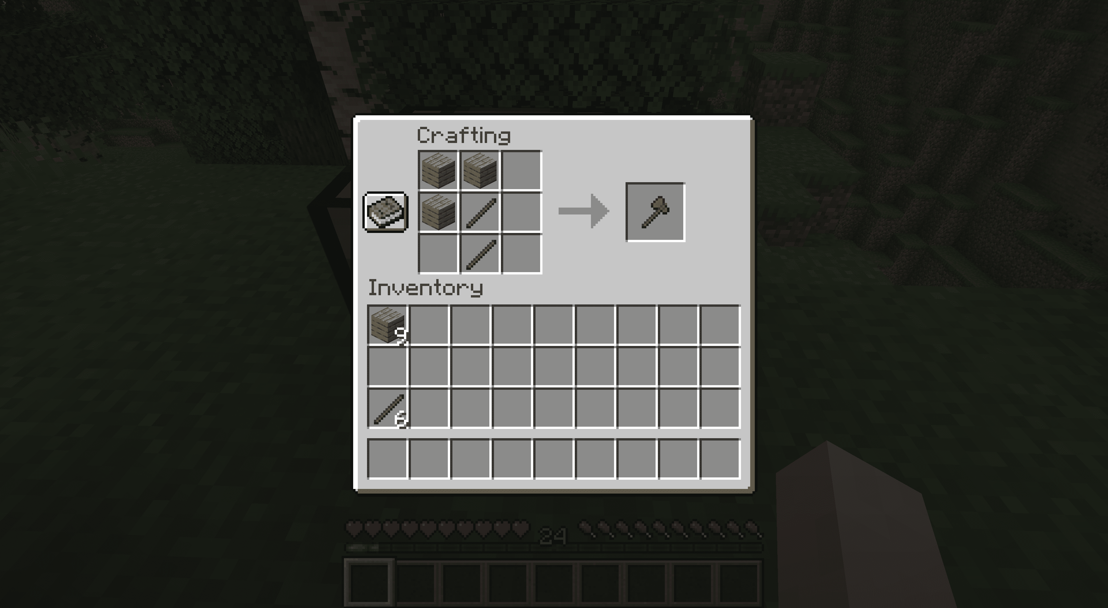 Making an axe in Minecraft with sticks and planks.