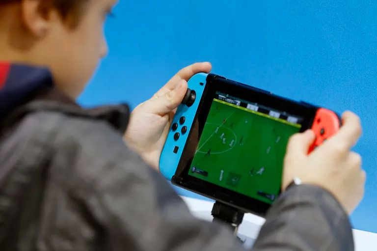 Child playing with a Nintendo Switch