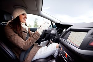 Women inside of the car, using navigational equipment