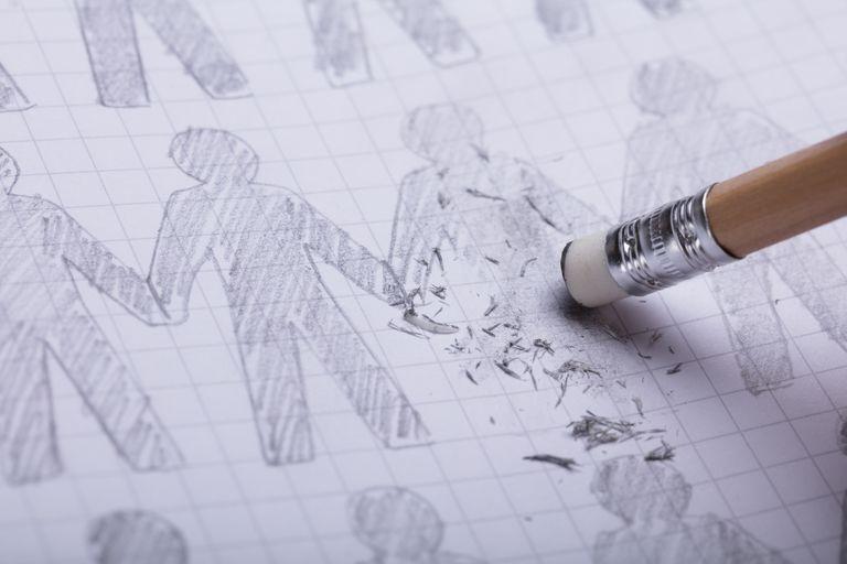 Pencil erasing hand-drawn people on paper