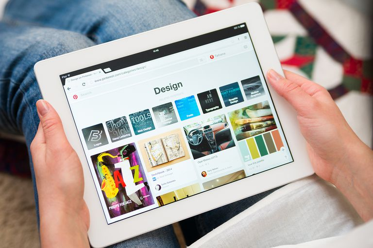 Woman using Pinterest on tablet