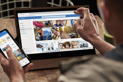 OneDrive open on laptop and smartphone.