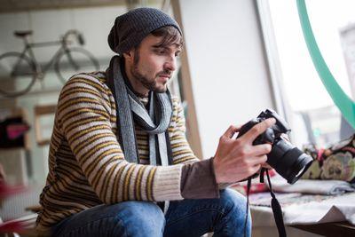 A photographer reviews his photos.