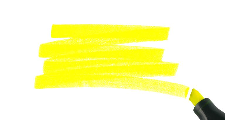 Yellow highlighter pen on a white background.
