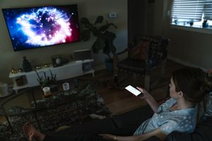 woman streaming iphone to TV