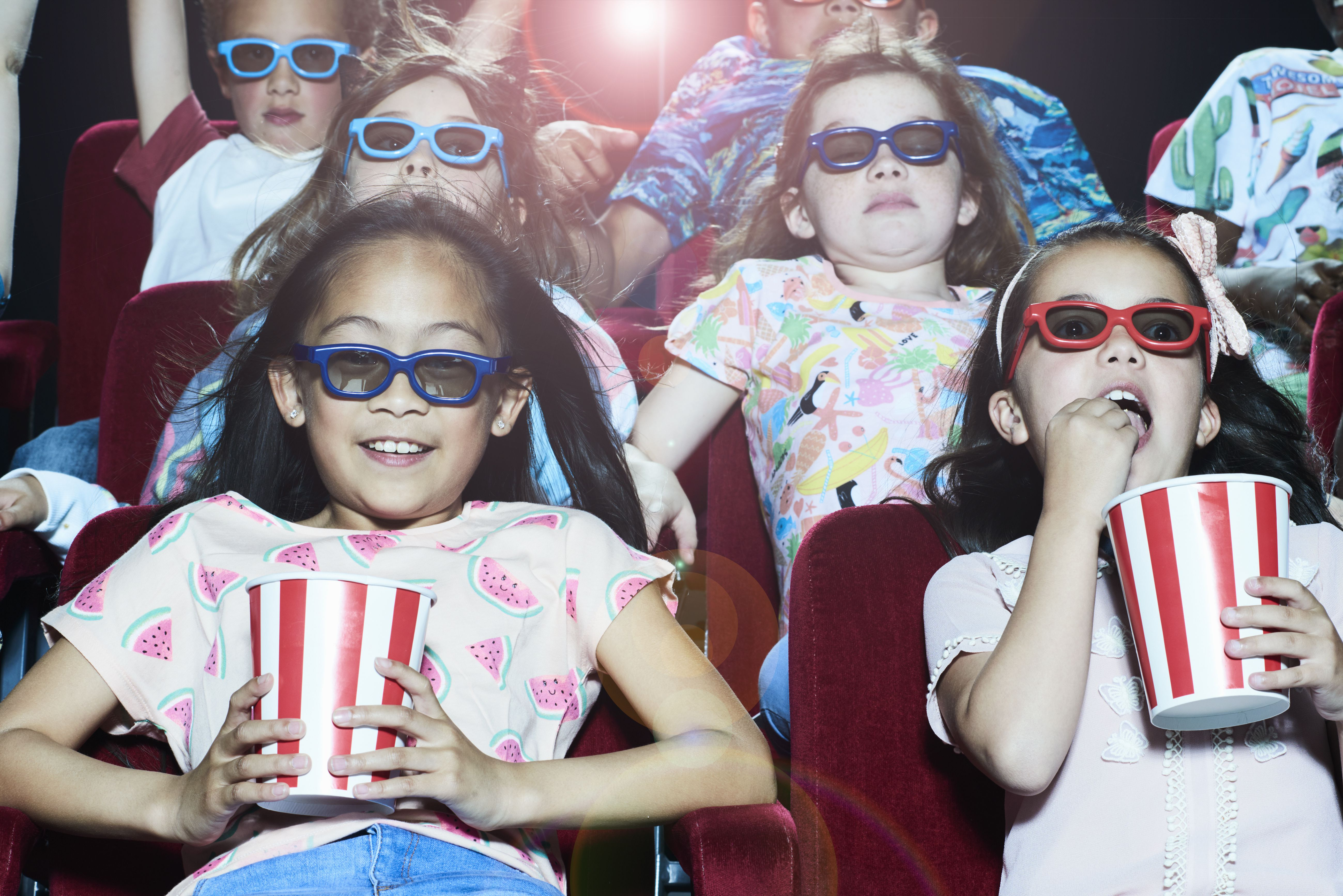 Group of children enjoying a 3D movie at the cinema