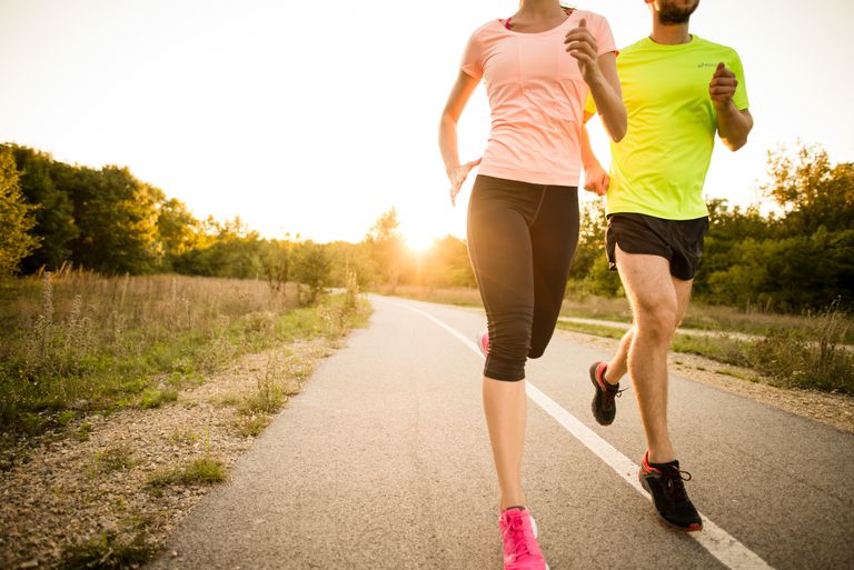 Couple jogging on a trail