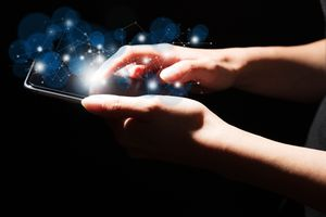 Hands holding cell phone, browsing abstract 'web'