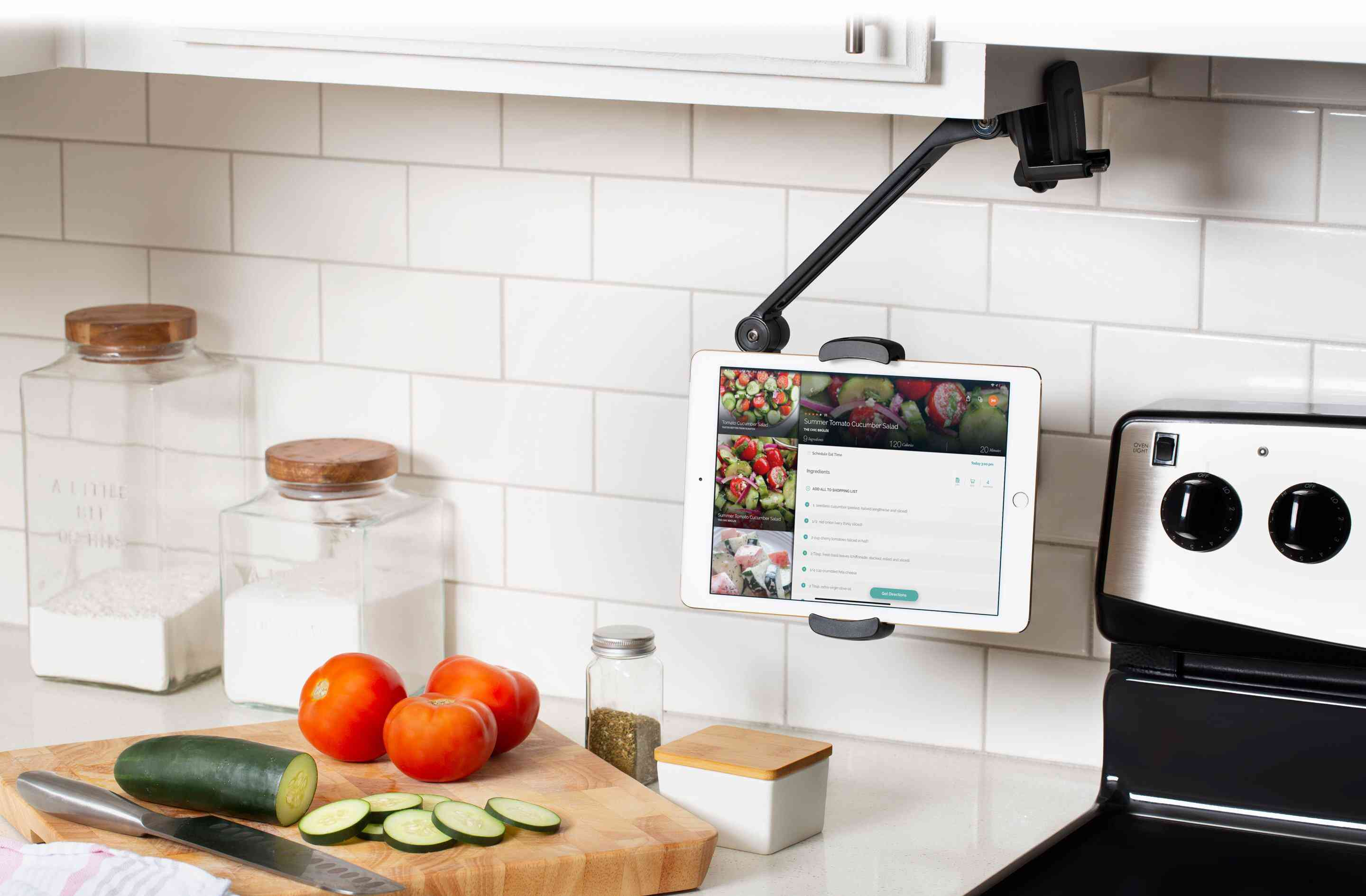 An iPad mounted under a kitchen counter with the TwelveSouth HoverBar.