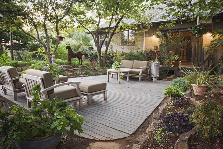 Backyard garden patio with cushioned lounge chairs