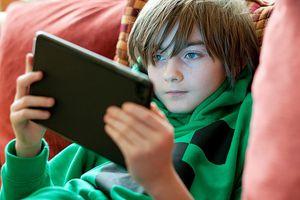 Kid playing on iPad