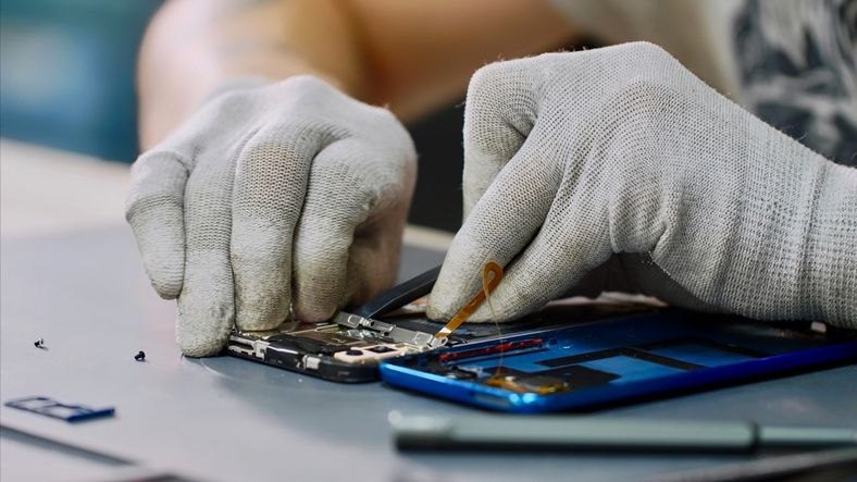 Close-Up Of Hands Working On a Smartphone