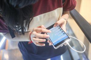 A young woman sending a text