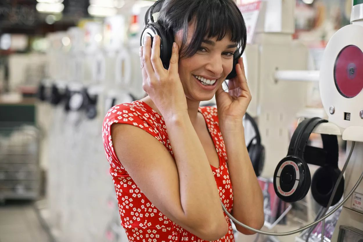Shopper trying on headphones in a store