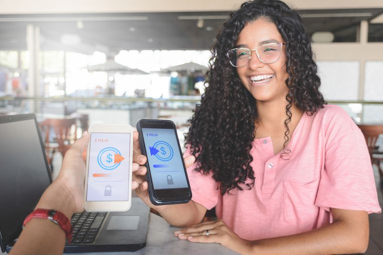 A woman receiving a digital payment on her phone