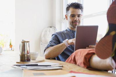 A man reads an ebook using Apple Books.